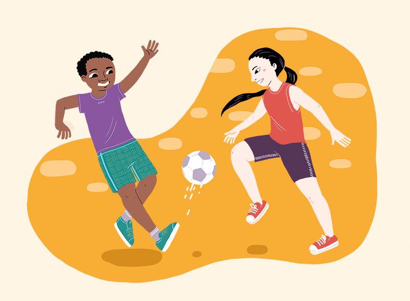 Boy and girl playing football